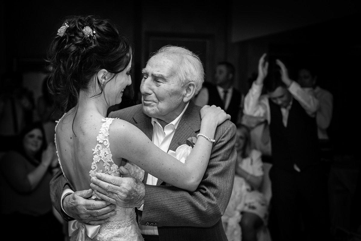 Bride dancing with granddad