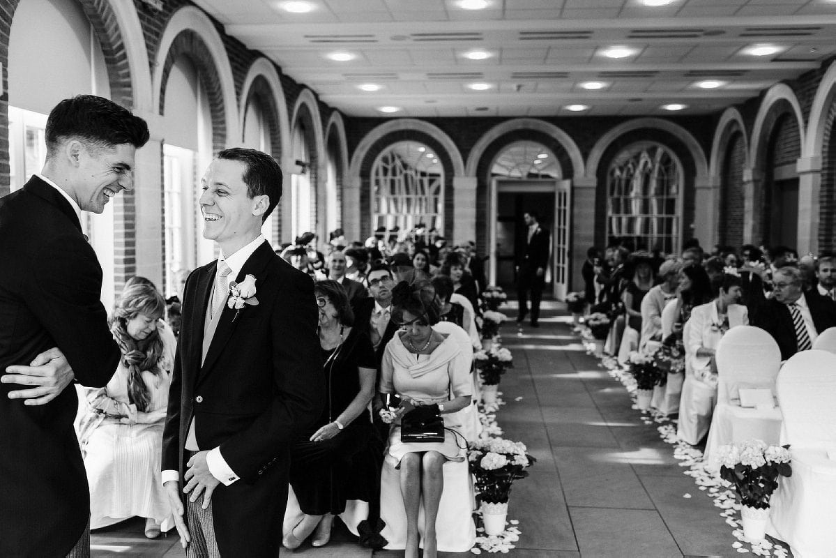 Groom waiting in the aisle