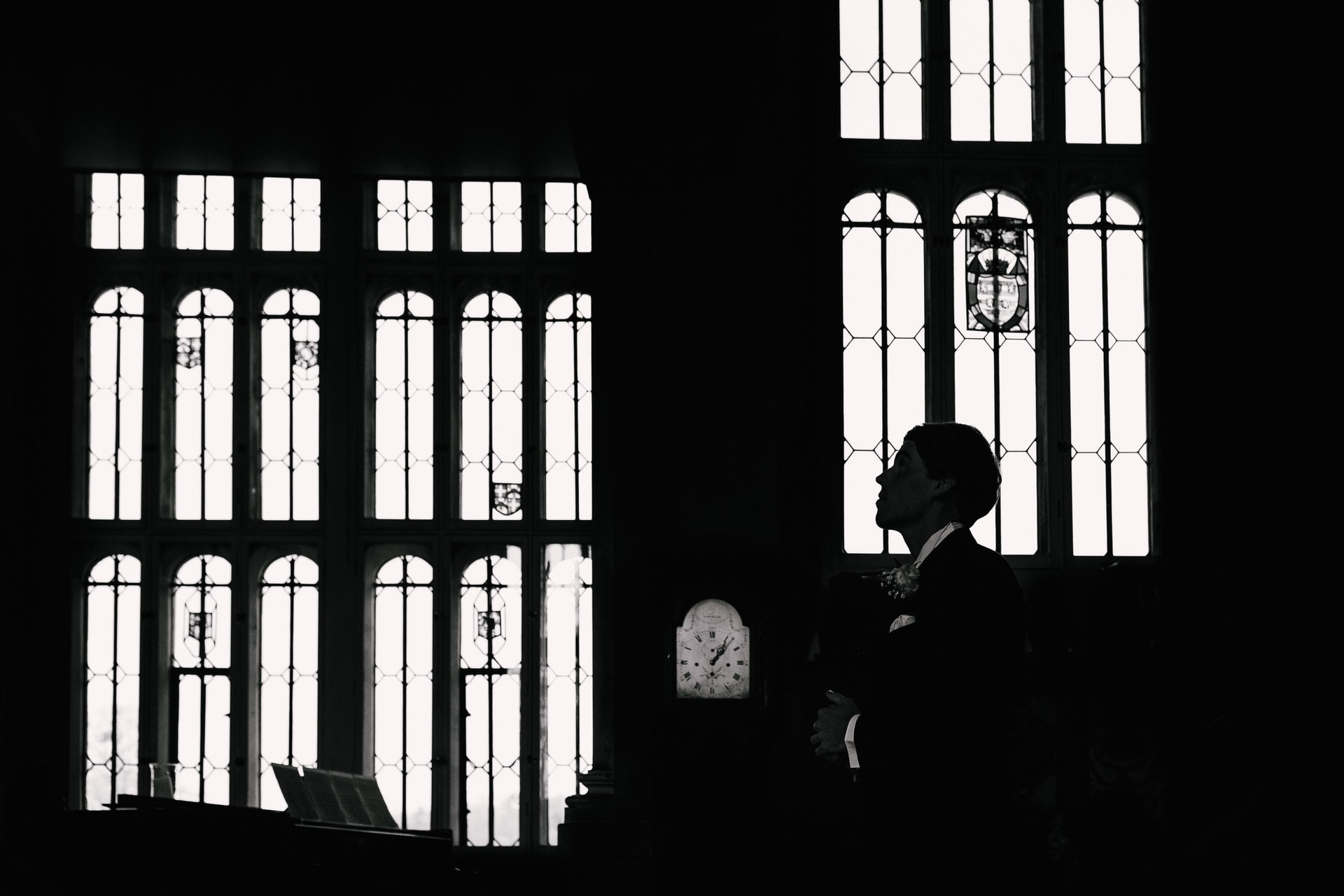Silhouette of groom in chapel - Best Loseley Park wedding photographer