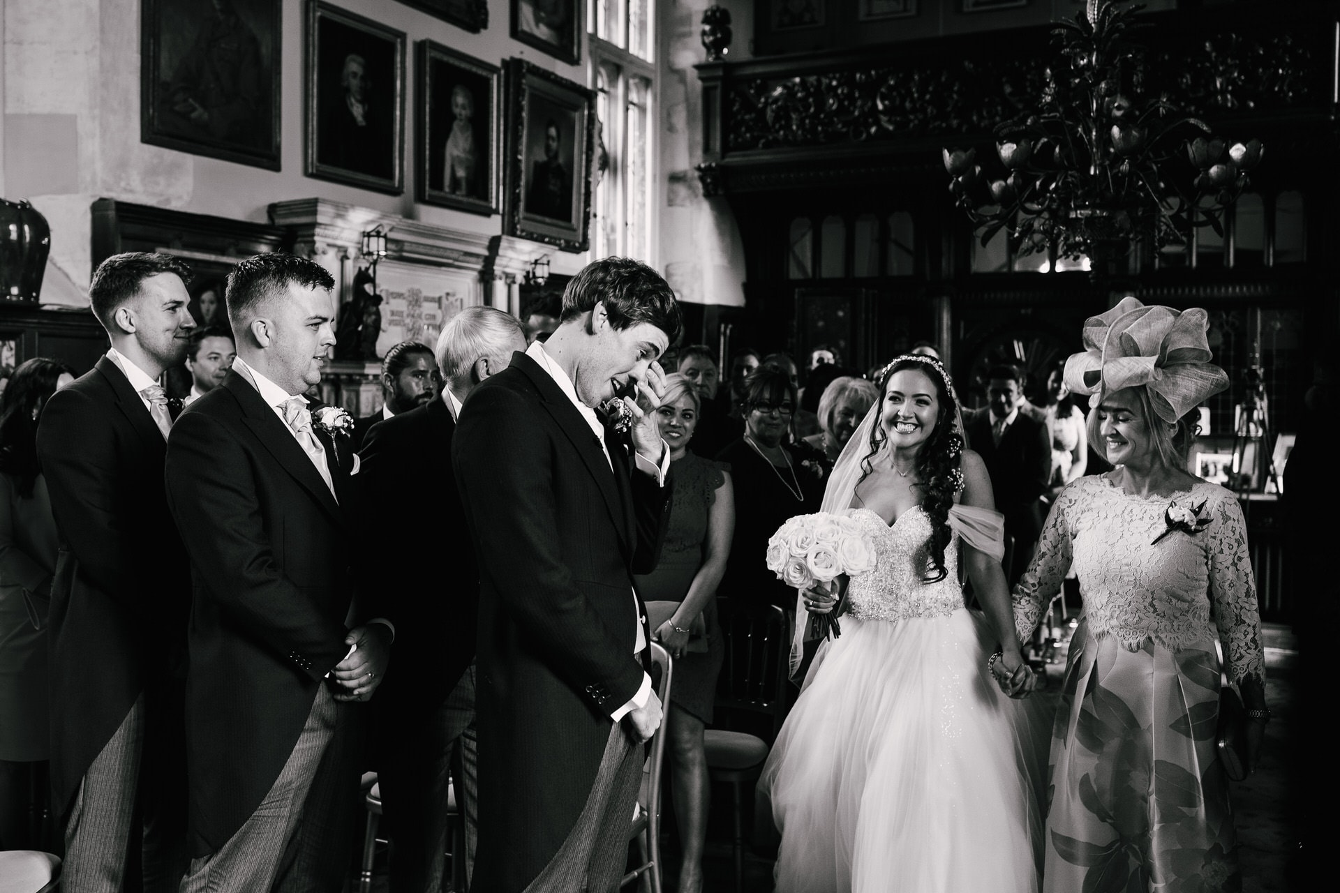 Groom's reaction as he sees bride walking down the aisle at Loseley Park Wedding