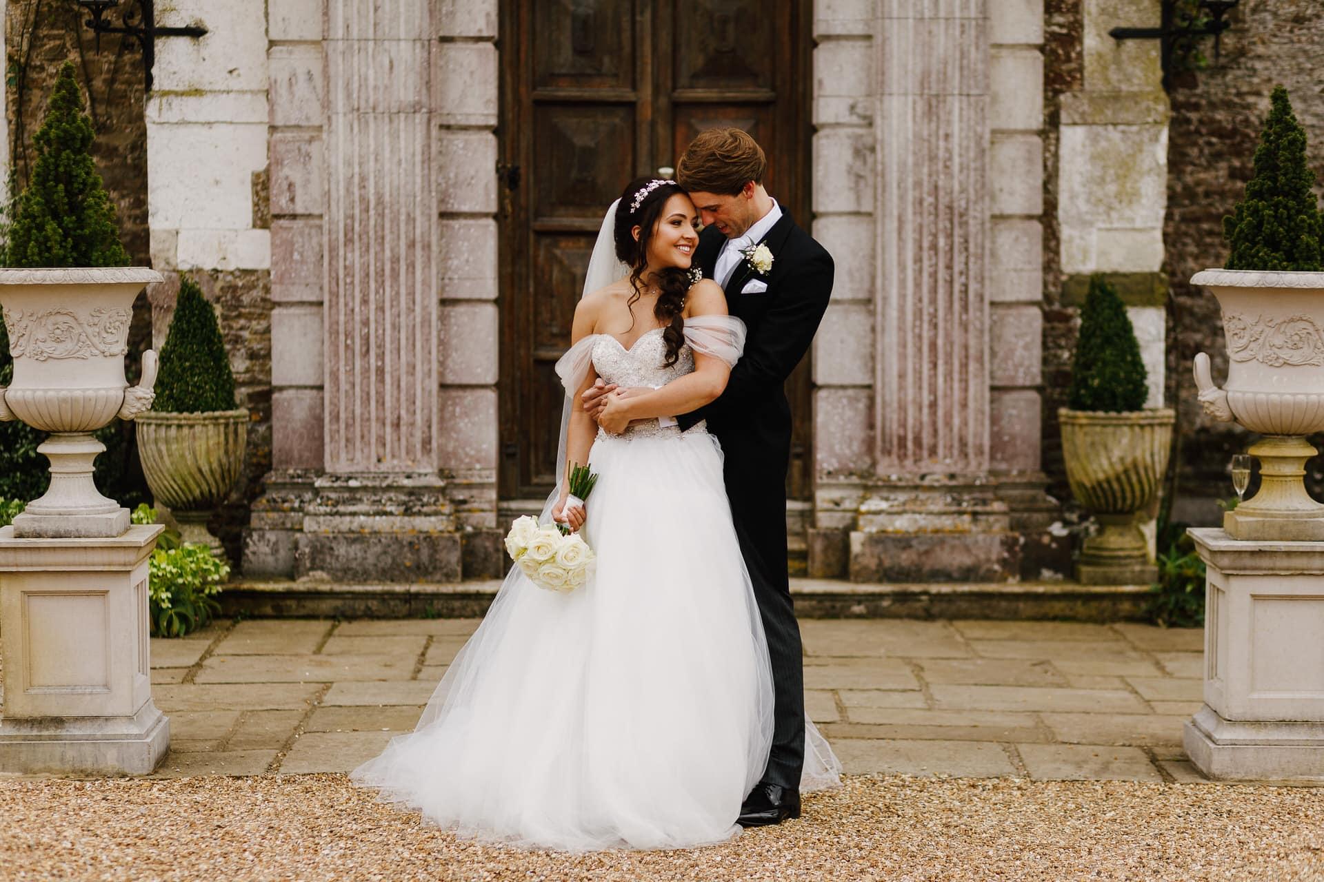 Couple portrait outside Loseley Park wedding in Surrey