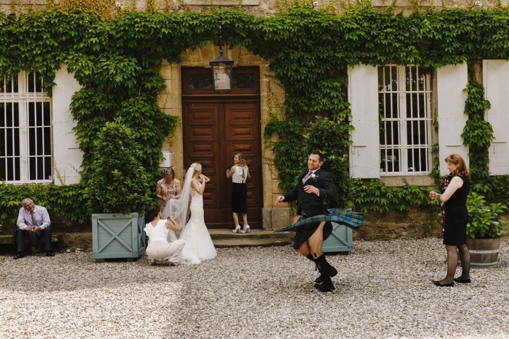 Fun wedding photographer at Chateau Blomac