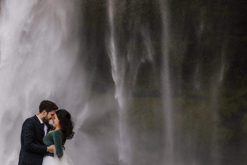 Couple in front of Seljalandsfoss waterfall in Iceland