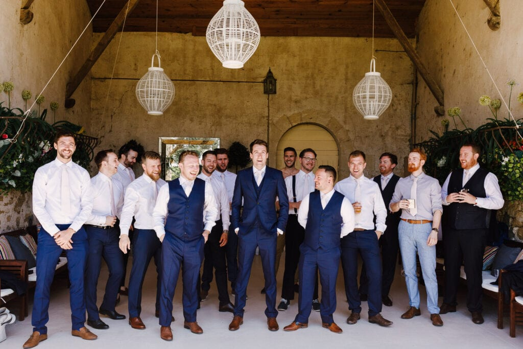 Groomsmen in barn at Chateau Soulac