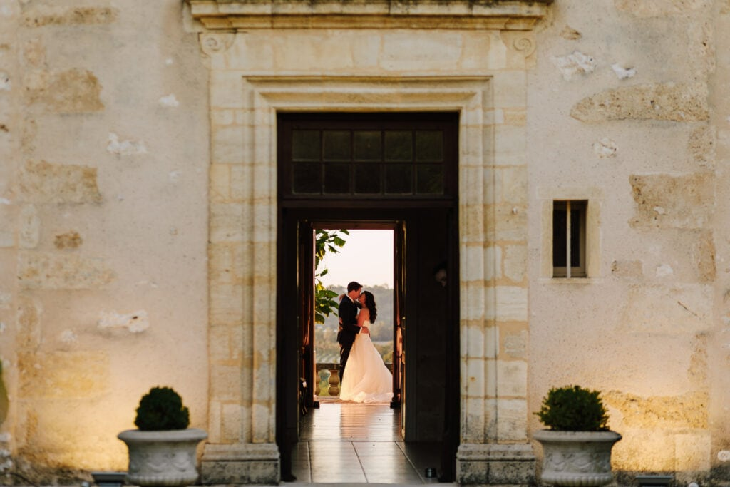 Bride and Groom through doorway at Chateau Soulac