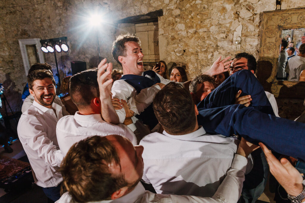 Crowd-surfing groom at Chateau Soulac